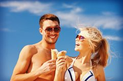 Happy couple with ice cream Stock Image