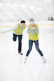 Happy couple in the ice rink Stock Photos