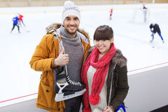Happy couple with ice-skates on skating rink Royalty Free Stock Photo