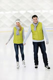 Happy couple ice skating Royalty Free Stock Image