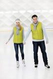 Happy couple ice skating Royalty Free Stock Image