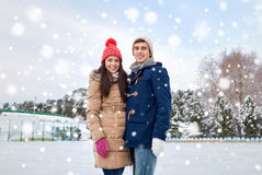 Happy couple ice skating on rink outdoors Stock Photo