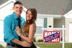 Happy Couple if Front of Newly Sold Home Royalty Free Stock Image