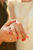 Happy couple II. Close-up photo of a caucasian couple's hands on their wedding day Royalty Free Stock Images
