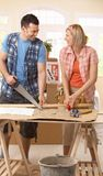 Happy couple improving new house. Working together at table Royalty Free Stock Photo