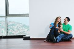 Happy Couple In Empty Apartment Royalty Free Stock Photos