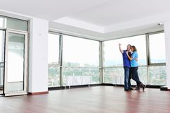 Happy Couple In Empty Apartment Royalty Free Stock Image
