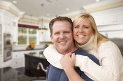 Happy Couple Inside Beautiful Custom Kitchen Royalty Free Stock Photography