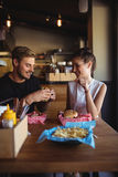 Happy couple interacting while fast food Stock Photo