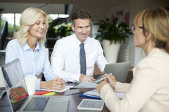 Happy couple with investment advisor