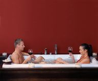 Happy couple in jacuzzi Royalty Free Stock Photography
