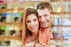 Happy couple in jewelry store Stock Photos