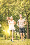 Happy couple jogging and running in the park - Fitness concept Royalty Free Stock Image
