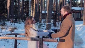 Happy couple joyfully meets on bridge in the countryside on Valentine`s Day stock video