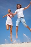 Happy couple in jump Stock Photos