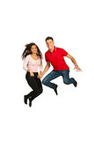 Happy couple jumping. Happy young couple jumping and holding their hands isolated on white background Stock Photo
