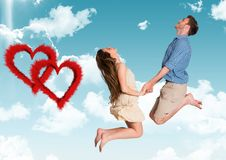 Happy couple jumping against sky background. Composite image of happy couple jumping against sky background Stock Images