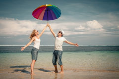 Happy couple jumping on the beach Stock Photo
