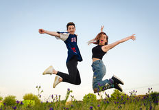 Happy couple jumping Royalty Free Stock Photos