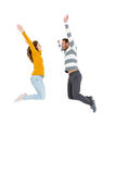 Happy couple jumping in excited. On white background Royalty Free Stock Images
