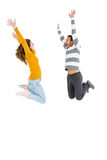 Happy couple jumping in excited. On white background Royalty Free Stock Photo