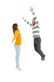 Happy couple jumping in excited. On white background Stock Photo