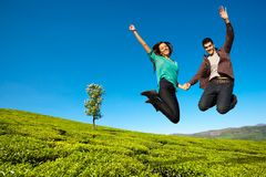 Happy couple jumping high stock photo