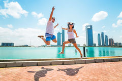 Happy couple jumping on holidays in Abu Dhabi. United Arab Emirates Royalty Free Stock Photos