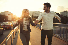 Happy couple jumping from joy. In sunset Royalty Free Stock Photography