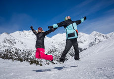 Happy couple jumping in mountains Royalty Free Stock Photo