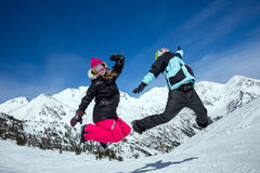 Happy couple jumping in mountains Royalty Free Stock Photography
