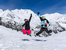 Happy couple jumping in mountains Stock Image