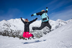 Happy couple jumping in mountains Royalty Free Stock Image