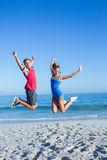 Happy couple jumping together Royalty Free Stock Photo