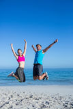 Happy couple jumping together Stock Photos