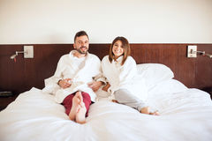 Happy couple just arrived at a hotel Stock Images