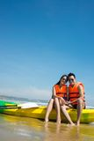 Happy couple on the kayak boat Stock Photos