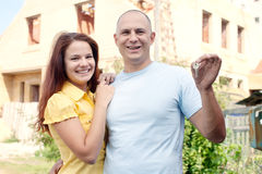 Happy couple with key Stock Photos
