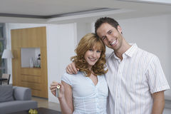 Happy Couple With Key In New Home Stock Images