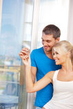 Happy couple with keys Royalty Free Stock Photo