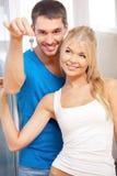 Happy couple with keys Stock Image