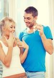 Happy couple with keys Stock Photography