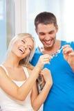Happy couple with keys Stock Photos