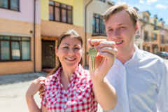 Happy couple with keys to a new home Stock Photography