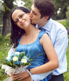 Happy couple in a kiss and hug romantic moment royalty free stock photo