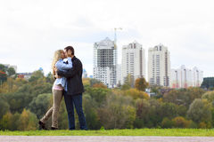 Happy couple kissing. Against building new brick house Royalty Free Stock Image