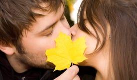 Happy couple kissing. (autumn concept royalty free stock photo