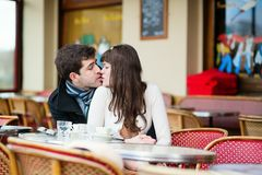Happy couple kissing in a cafe Stock Image