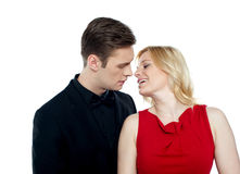 Happy couple kissing each other. In front of camera Royalty Free Stock Images