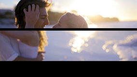 Happy couple kissing each other on the beach Stock Photos
